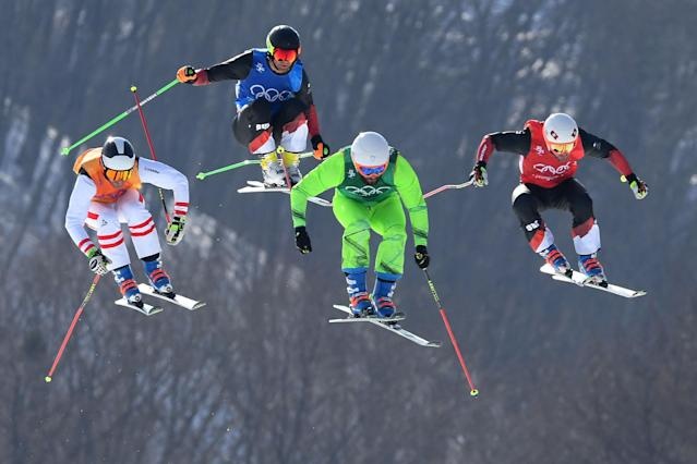 <p>Armin Niederer of Switzerland, Filip Flisar of Slovenia, Thomas Zangerl of Austria and Jonas Lenherr of Switzerland compete in the Freestyle Skiing Men's Ski Cross Quarterfinals on day 12 of the PyeongChang 2018 Winter Olympic Games at Phoenix Snow Park on February 21, 2018 in Pyeongchang-gun, South Korea. (Photo by Quinn Rooney/Getty Images) </p>