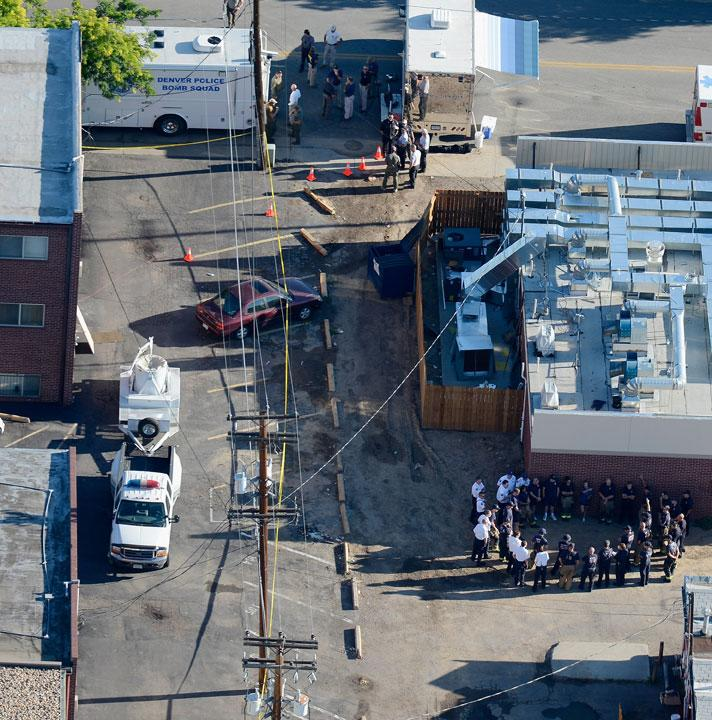 AURORA, CO - JULY 21:  Seen from the air, police and fire fighters surround the booby-trapped apartment of suspect James Holmes after he went on a shooting rampage at nearby Century 16 movie theatre during an early morning screening of the new Batman movie, 'The Dark Knight Rises,' on July 21, 2012 in Aurora, Colorado. According to reports, 12 people have been killed and over 59 injured including 9 in critical condition. Police have the suspect, twenty-four year old James Holmes of North Aurora, in custody.