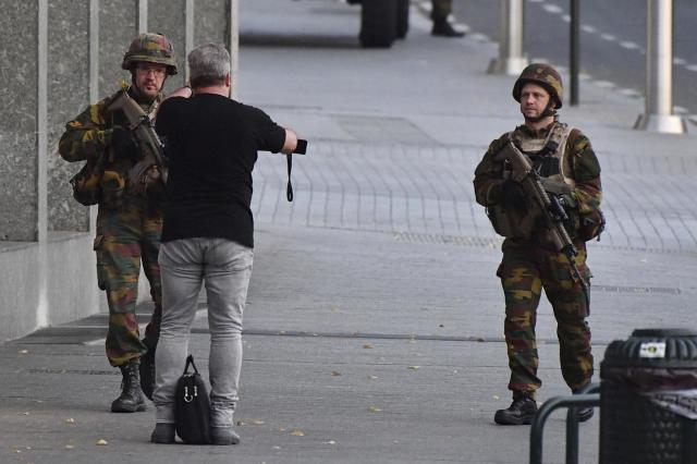 <p>Belgian Army soldiers approaches a man outside Central Station after a reported explosion in Brussels on Tuesday, June 20, 2017. Belgian media are reporting that explosion-like noises have been heard at a Brussels train station, prompting the evacuation of a main square. (AP Photo/Geert Vanden Wijngaert) </p>