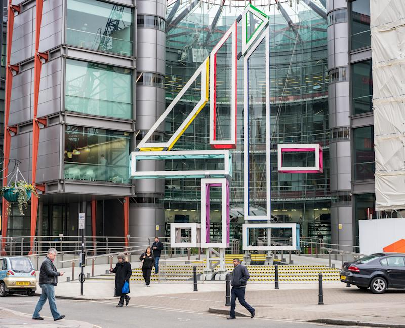 London, UK - Pedestrians on the street in front of the headquarters building of the UK television broadcaster Channel 4, located in Westminster. Credit: Getty.