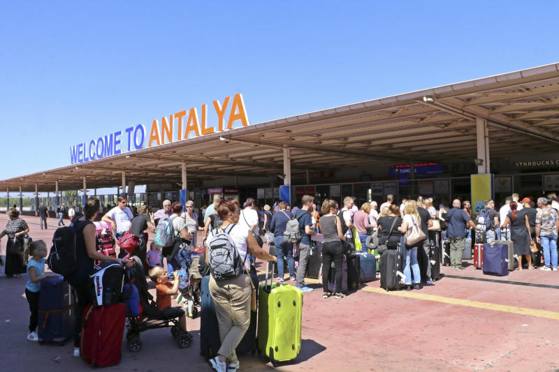 British passengers with Thomas Cook wait in long queue at Antalya airport in Antalya, Turkey, Monday Sept. 23, 2019. Hundreds of thousands of travellers were stranded across the world Monday after British tour company Thomas Cook collapsed, immediately halting almost all its flights and hotel services and laying off all its employees. According to reports Monday morning some 21,000 Thomas Cook travellers were stranded in Turkey alone.(IHA via AP)