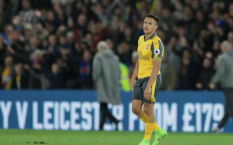 Trudging: Alexis Sanchez took it all deeply personally, while Arsene Wenger tried to slip away quietly - AP