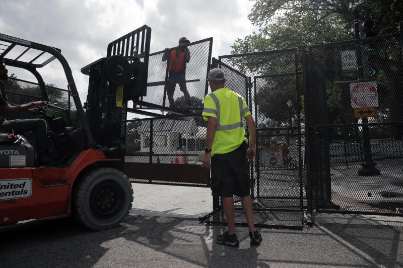 A temporary perimeter fence surrounding the White House is removed, Wednesday, June 10, 2020, in Washington. The fence was put up because of the protests that began over the death of George Floyd, a black man who was in police custody in Minneapolis. Floyd died after being restrained by Minneapolis police officers. (AP Photo/Carolyn Kaster)