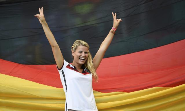 A German fan gestures as she waits for the 2014 World Cup Group G soccer match between Germany and Portugal at the Fonte Nova arena in Salvador, June 16, 2014. REUTERS/Dylan Martinez (BRAZIL - Tags: SOCCER SPORT WORLD CUP)