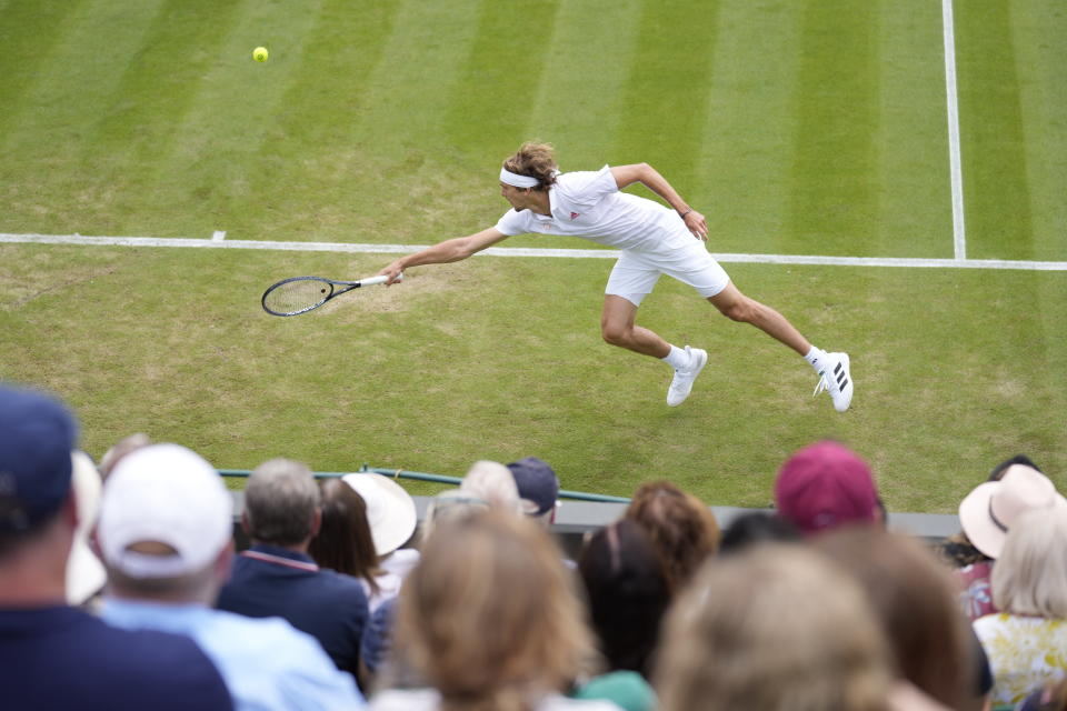 Germany's Alexander Zverev plays a return to Tennys Sandgren of the US during the men's singles second round match on day four of the Wimbledon Tennis Championships in London, Thursday July 1, 2021. (AP Photo/Kirsty Wigglesworth)