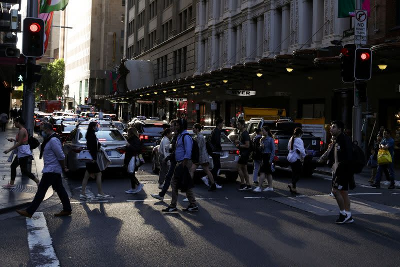 FILE PHOTO: People walk through a congested intersection in the city centre of Sydney