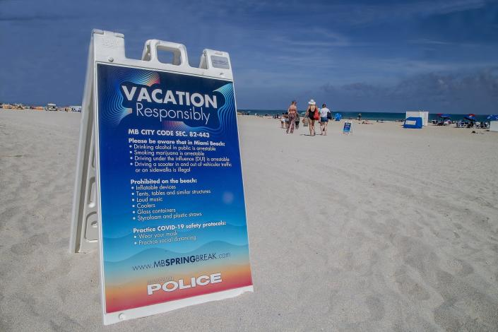 City of Miami Beach have placed signs along the beach as part of the Miami Beach Vacation Responsibly campaign advising spring breakers of the zero tolerance rules, Tuesday, March 2, 2021 in Miami Beach, Fla. Miami Beach officials are imposing an emergency 8 p.m.-6 a.m. curfew effective immediately, saying large, out-of-control spring break crowds crammed the beaches, trashed some restaurant properties and brawled in the streets. Tourists and hotel guests are being told to stay indoors during the curfew hours. (Pedro Portal/Miami Herald via AP)