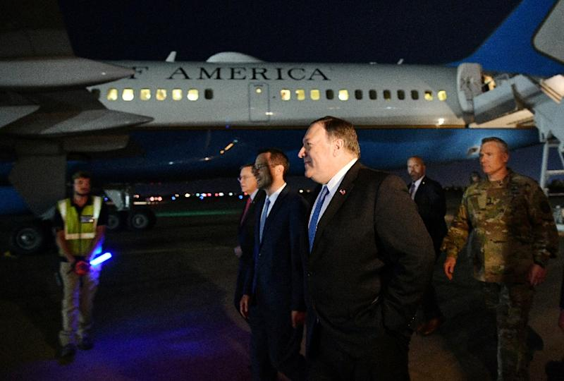 Secretary of State Mike Pompeo walks with senior US officials as he arrives on a surprise visit to Baghdad (AFP Photo/MANDEL NGAN)