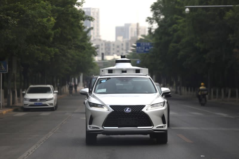 Lexus vehicle equipped with Pony.ai's autonomous driving system drives on a road during a test event, in Beijing