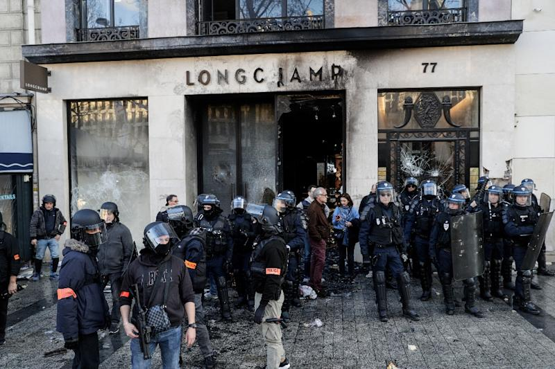 Luxury handbag store Longchamp was among the shops targeted by the rioters on the Champs-Elysees (AFP Photo/Geoffroy VAN DER HASSELT)