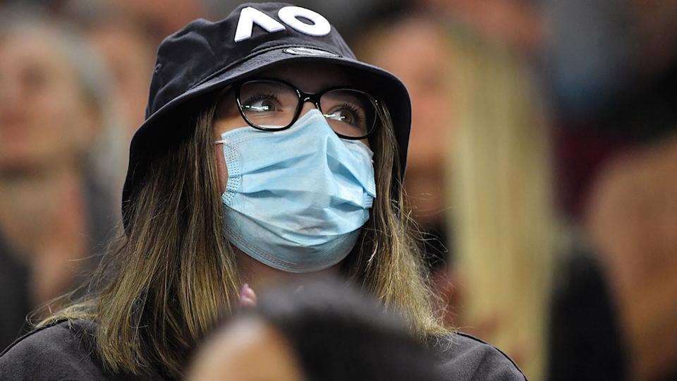 A fan, pictured here wearing a face mask at the Australian Open.