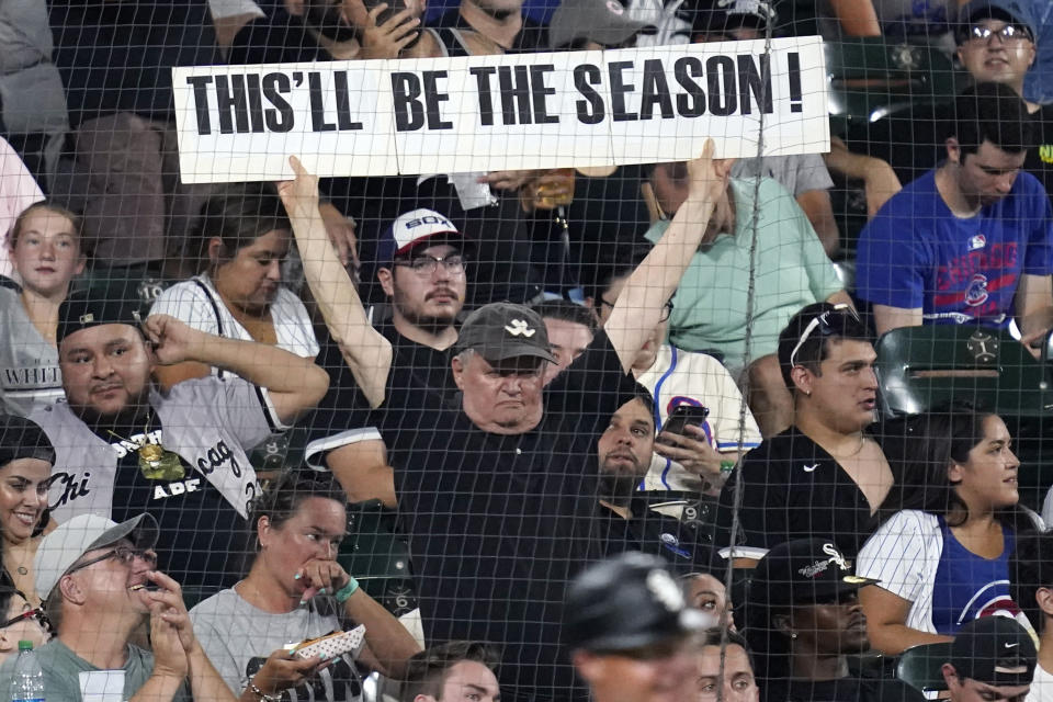 A spectator holds a sign during the fifth inning of the team's baseball game against the Chicago Cubs on Friday, Aug. 27, 2021, in Chicago. (AP Photo/Nam Y. Huh)
