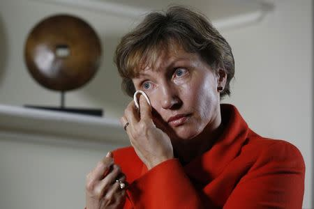 Marina Litvinenko, the wife of former KGB agent Alexander Litvinenko who was murdered in London in 2006, wipes away a tear during an interview with Reuters in London January 21, 2015. REUTERS/Luke MacGregor