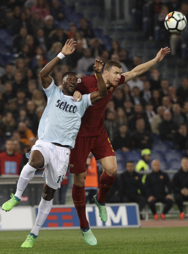 Lazio's Bastos, left, and Roma's Edin Dzeko vie for the ball during an Italian Serie A soccer match between AS Roma and Lazio, at the Olympic stadium in Rome, Sunday, April 15, 2018. (AP Photo/Gregorio Borgia)