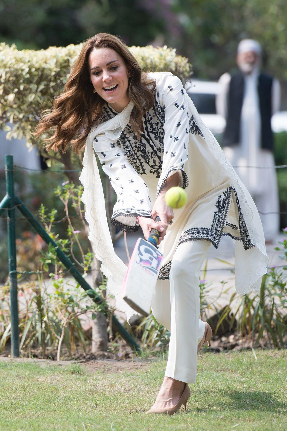 <p>The duchess takes a swing during a game of cricket in Lahore, Pakistan.</p>