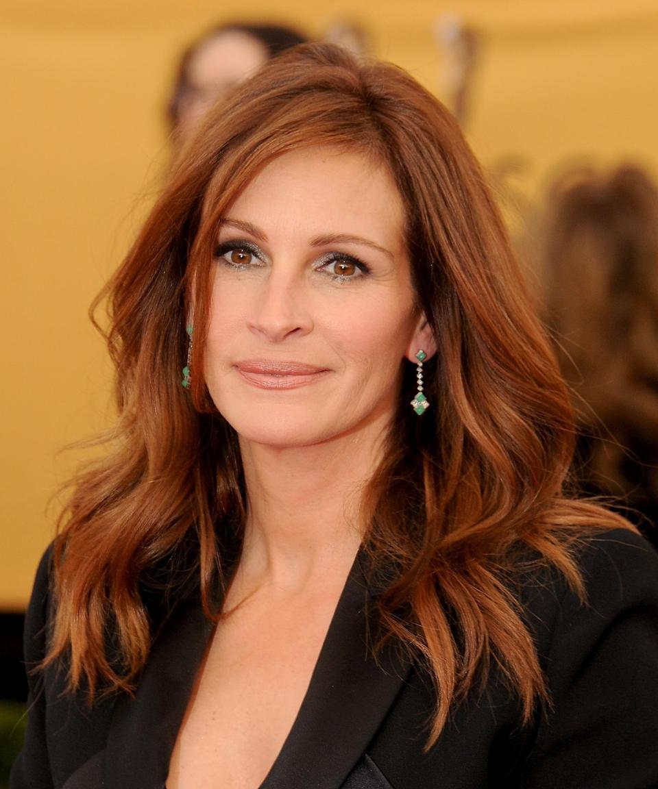 """<strong><h2>Julia Roberts</h2></strong>Roberts might have made her Hollywood debut as a brunette — remember <em>Mystic Pizza</em>? — but she's most recognizable as a redhead, thanks to her rom-com hits, like <em><a href=""""https://www.refinery29.com/en-us/2017/12/185924/julia-roberts-red-hair-2017"""" rel=""""nofollow noopener"""" target=""""_blank"""" data-ylk=""""slk:Pretty Woman"""" class=""""link rapid-noclick-resp"""">Pretty Woman</a></em> and <em>My Best Friend's Wedding</em>. While she spends most of her time today being a sun-kissed blonde, she sometimes goes back to her (fake) roots every now and again.<span class=""""copyright"""">Photo: Gregg DeGuire/WireImage.</span>"""