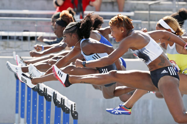 Keni Harrison, left, clears a hurdle ahead of fellow competitors during the women's 100-meter hurdles at the U.S. Championships athletics meet, Saturday, July 27, 2019, in Des Moines, Iowa. (AP Photo/Charlie Neibergall)