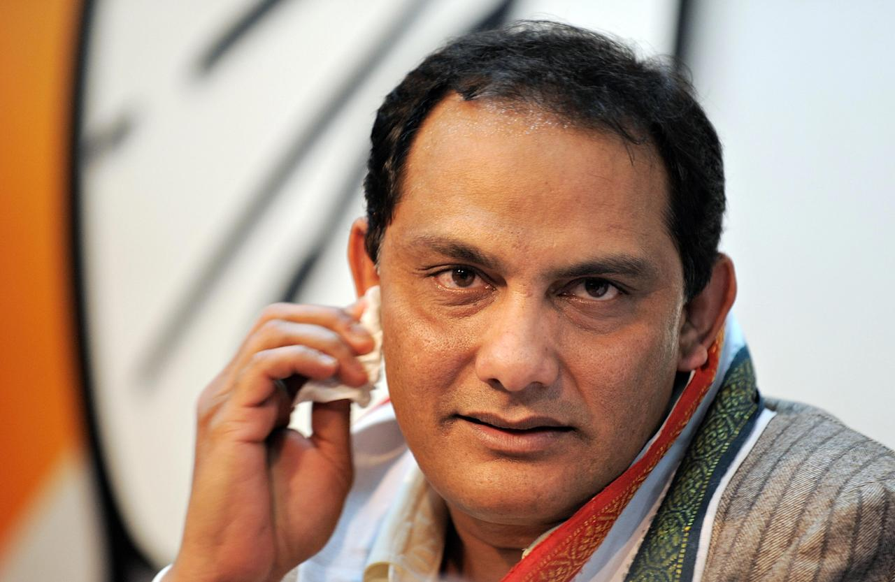 Former India cricket captain Mohammad Azharuddin wipes sweat from his face while addressing mediapersons at the Congress party headquarters in New Delhi on February 19, 2009. Former India cricket captain Mohammad Azharuddin, who was forced to quit the game after a match-fixing scandal, entered the country's turbulent political scene on February 19. Azharuddin, 46, was paraded for the media at the Congress headquarters in New Delhi after joining the ruling party ahead of upcoming parliamentary elections.   AFP PHOTO/ MANAN VATSYAYANA (Photo credit should read MANAN VATSYAYANA/AFP/Getty Images)