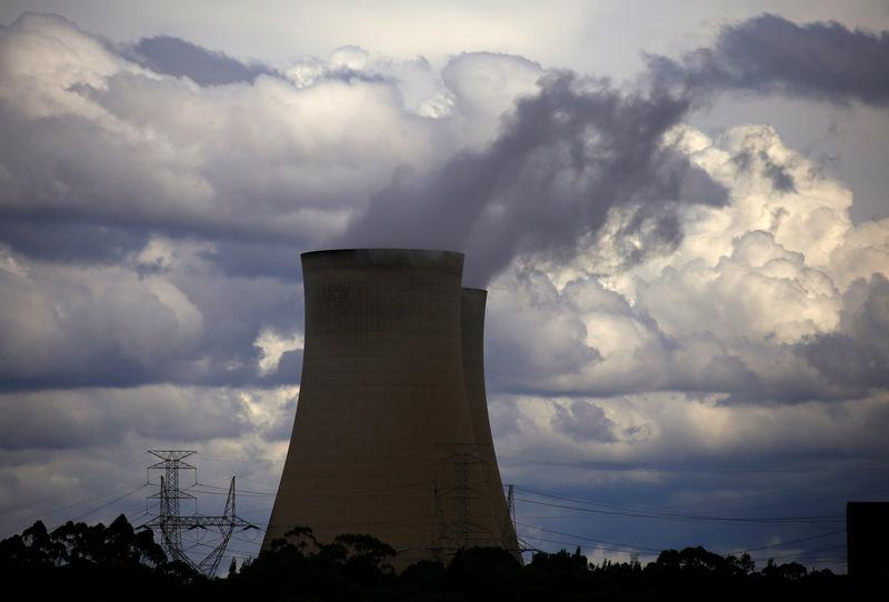 Storm clouds can be seen above the Bayswater coal-powered thermal power station located near the central New South Wales town of Muswellbrook