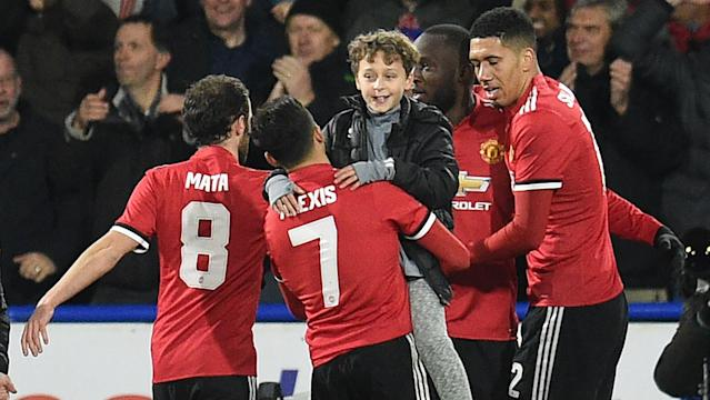 A handful of Red Devils supporters joined in the celebrations on the pitch after Romelu Lukaku's second goal at the John Smith's Stadium