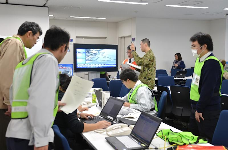 Officers at the Fukushima prefectural office gather data following an earthquake that hit the prefecture on November 22, 2016 (AFP Photo/JIJI PRESS)