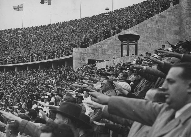 A crowd gives the Nazi salute during the 1936 Olympics.