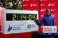 Kenya's Brigid Kosgei smiles after winning the women's 2019 Chicago Marathon with a world record of 2:14:04 (AFP Photo/KAMIL KRZACZYNSKI)
