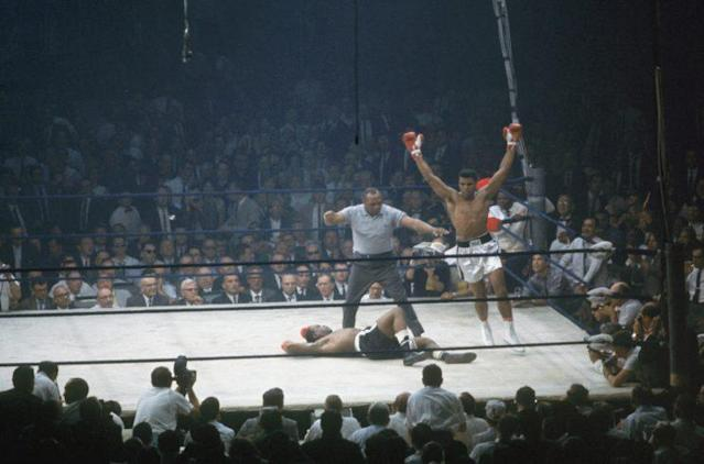 Muhammad Ali, who died on June 3 in a Phoenix hospital at 74 years of age, celebrates a 1965 knockout win of Sonny Liston. (Getty Images)