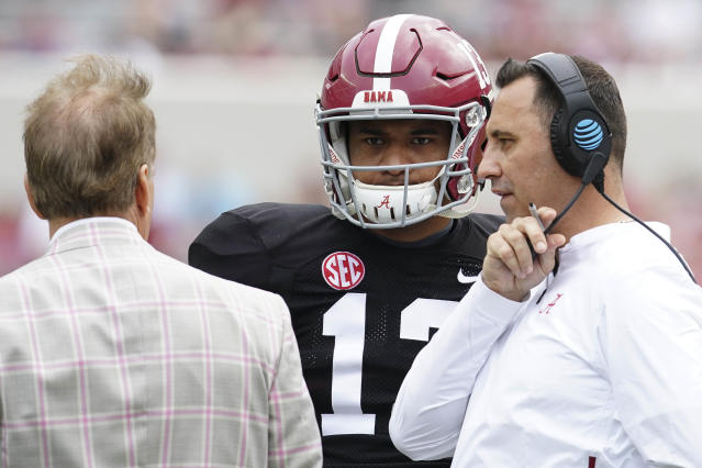 Alabama Crimson Tide quarterback Tua Tagovailoa (13) talks with Alabama Crimson Tide head coach Nick Saban and offensive coordinator Steve Sarkisian at Bryant-Denny Stadium. (Credit: USAT)