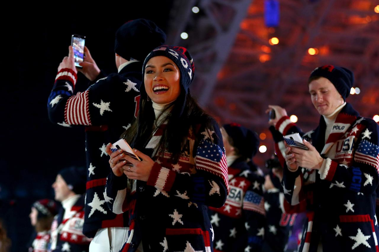 SOCHI, RUSSIA - FEBRUARY 07: Figure skater Madison Chock enters the stadium with the United States Olympic team during the Opening Ceremony of the Sochi 2014 Winter Olympics at Fisht Olympic Stadium on February 7, 2014 in Sochi, Russia. (Photo by Ryan Pierse/Getty Images)