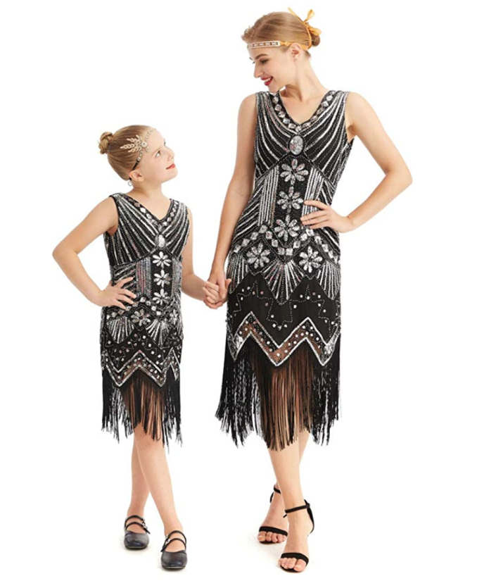 """<p>Embrace the roaring '20s with your daughter by dressing up as glamorous flapper girls. Bonus points for doing a mother-daughter dance routine featuring the Charleston!<br></p><p><a class=""""link rapid-noclick-resp"""" href=""""https://www.amazon.com/AMJM-Parent-Childs-Nouveau-Embellished-Fringed/dp/B07KLRTL8G/ref=sr_1_14?tag=syn-yahoo-20&ascsubtag=%5Bartid%7C2164.g.37079496%5Bsrc%7Cyahoo-us"""" rel=""""nofollow noopener"""" target=""""_blank"""" data-ylk=""""slk:SHOP MOMMY & ME FLAPPERS COSTUME"""">SHOP MOMMY & ME FLAPPERS COSTUME</a></p>"""