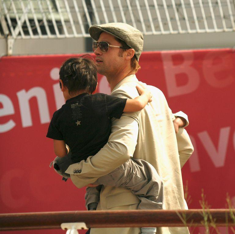 <p>Brad Pitt carries one of his children with Angelina Jolie as they head to the Venice airport in September 2007. </p>