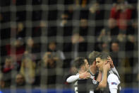 Juventus' Cristiano Ronaldo, right, celebrates with his teammates after scores his side's opening goal during the Champions League Group D soccer match between Bayer Leverkusen and Juventus at the BayArena in Leverkusen, Germany, Wednesday, Dec. 11, 2019. (AP Photo/Martin Meissner)