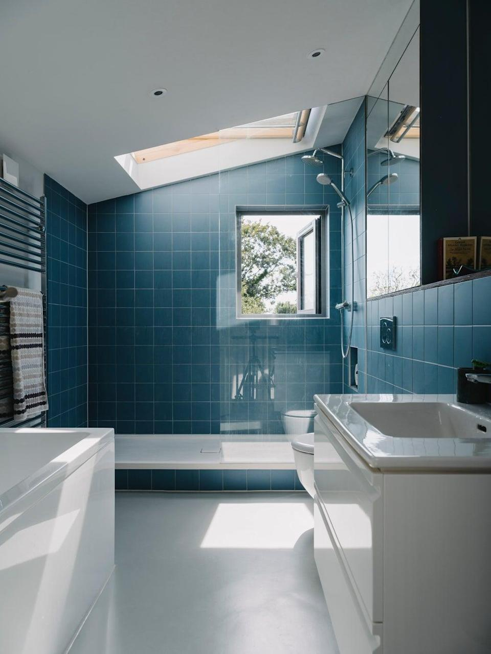 A new upstairs bathroom with skylight  was added above the back bedroom in a subtle structural reorganisation that did not require the hassle of a full planning application (Tim Crocker)