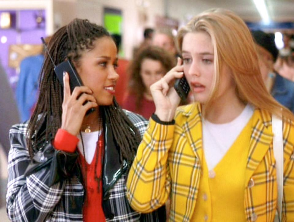 """LOS ANGELES - JULY 21: The movie """"Clueless"""", written and directed by Amy Heckerling. Seen here from left, Stacey Dash (as Dionne Davenport), and Alicia Silverstone (as Cher Horowitz).  Theyre using cell phones. Theatrical wide release, Friday, July 21, 1995. Screen capture. Paramount Pictures. (Photo by CBS via Getty Images)"""