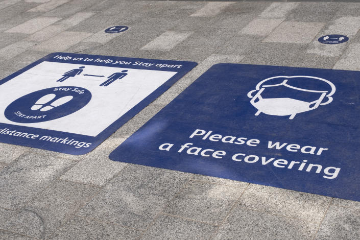 As the third national coronavirus lockdown continues, face mask wearing and social distancing advice signs outside Grand Central station on 30th March 2021 in Birmingham, United Kingdom. After months of lockdown, the first signs that life will start to get back to normal begin, with more people enjoying the company of others in public, as the rule of six starts the first stage of lockdown ending. (photo by Mike Kemp/In Pictures via Getty Images)