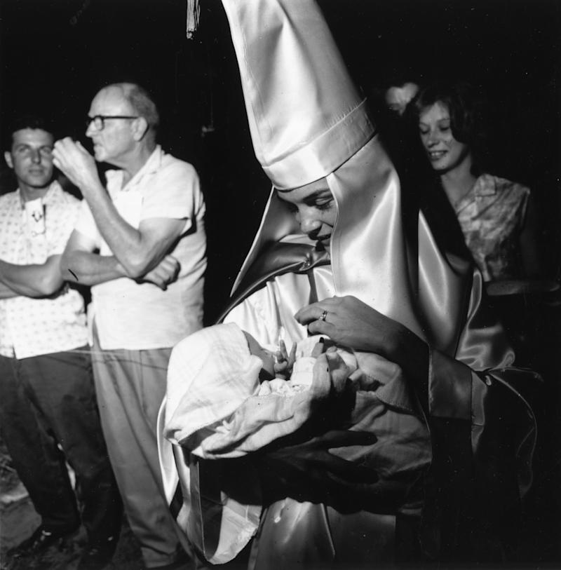 A woman member of the KKK takes her baby to a Klan meeting in South Carolina in 1965. (Harry Benson via Getty Images)