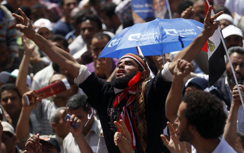 An Egyptian protester chants slogans during a rally in Tahrir Square in Cairo, Egypt, Friday, April 20, 2012. Tens of thousands of protesters packed Cairo's downtown Tahrir Square on Friday in the biggest demonstration in months against the ruling military, aimed at stepping up pressure on the generals to hand over power to civilians and bar ex-regime members from running in upcoming presidential elections. (AP Photo/Khalil Hamra)