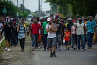 Haitian and Central American migrants march to the immigration offices in the southern Mexican city of Tapachula to demand documents (AFP/CLAUDIO CRUZ)