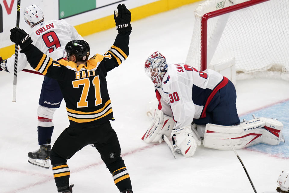 Boston Bruins left wing Taylor Hall (71) celebrates after scoring on Washington Capitals goaltender Ilya Samsonov (30) in the second period of Game 3 of an NHL hockey Stanley Cup first-round playoff series, Wednesday, May 19, 2021, in Boston. (AP Photo/Charles Krupa)