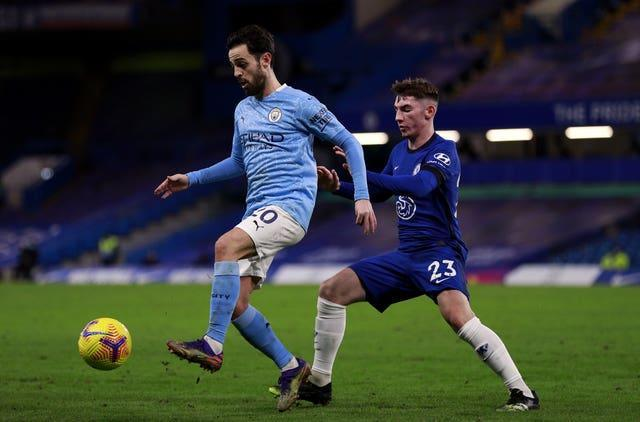 Bernardo Silva shields the ball from Billy Gilmour