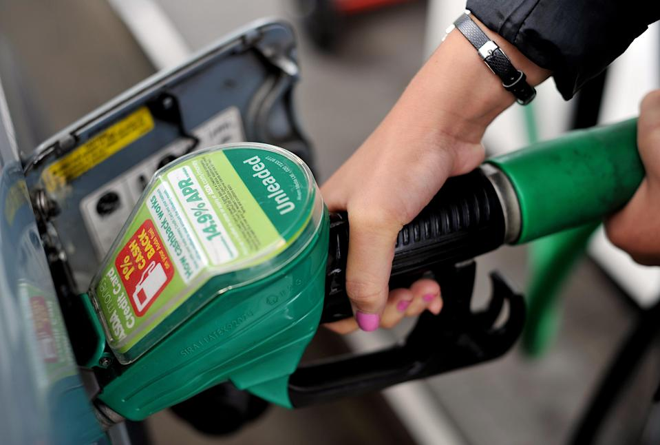 A view of a person using an Asda petrol pump in Chelmsford, Essex.   (Photo by Nick Ansell/PA Images via Getty Images)