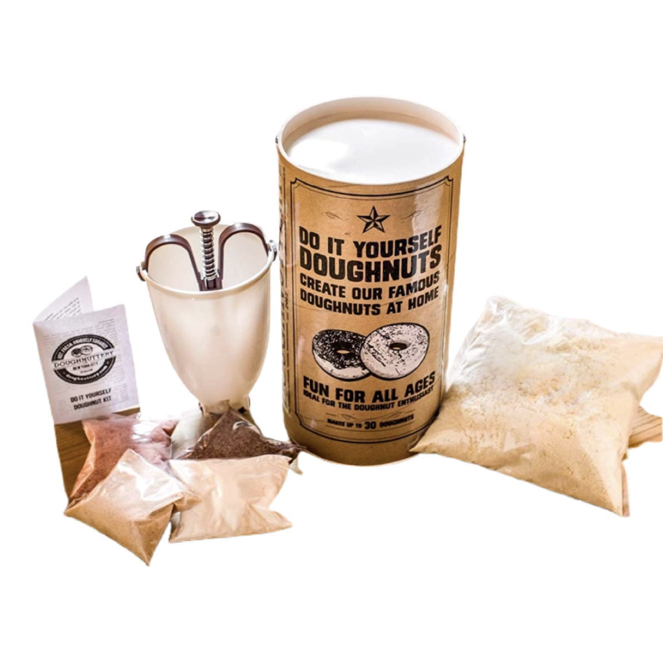 """<p><strong>Doughnuttery</strong></p><p>amazon.com</p><p><strong>$29.99</strong></p><p><a href=""""https://www.amazon.com/dp/B085CP7GV1?tag=syn-yahoo-20&ascsubtag=%5Bartid%7C10065.g.606%5Bsrc%7Cyahoo-us"""" rel=""""nofollow noopener"""" target=""""_blank"""" data-ylk=""""slk:Shop Now"""" class=""""link rapid-noclick-resp"""">Shop Now</a></p><p>He's probably gonna need some help eating all those doughnuts... Just sayin'. </p>"""