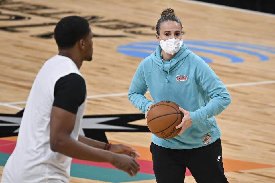 San Antonio Spurs assistant coach Becky Hammon, right, runs drills with forward Rudy Gay before the team's NBA basketball game against the Los Angeles Lakers, Friday, Jan. 1, 2021, in San Antonio. (AP Photo/Darren Abate)