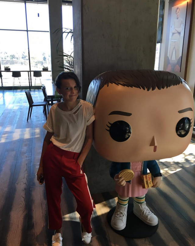 """<p>Leggo her Eggos! The <em>Stranger Things</em> star posed with her alter ego's giant Funko replica, complete with her infamous box of waffles. """"She's stalking me…"""" Brown wrote. (Photo: <a href=""""https://www.instagram.com/p/Barw1M0HdJk/?taken-by=milliebobbybrown"""" rel=""""nofollow noopener"""" target=""""_blank"""" data-ylk=""""slk:Millie Bobby Brown via Instagram"""" class=""""link rapid-noclick-resp"""">Millie Bobby Brown via Instagram</a>) </p>"""