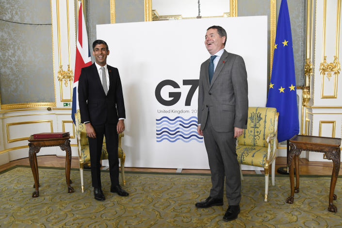 Britain's Chancellor of the Exchequer Rishi Sunak, left, poses for photos with Eurogroup President Paschal Donohoe as finance ministers from across the G7 nations meet at Lancaster House in London, Saturday, June 5, 2021 ahead of the G7 leaders' summit. (AP Photo/Alberto Pezzali, Pool)
