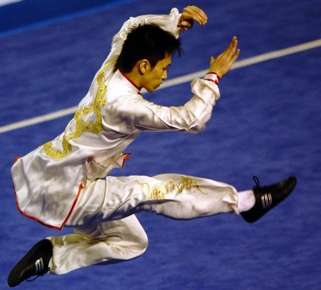 Singapore's Wee Key Seet competes in men's wushi taiji quan competition at the 26th Southeast Asian Games in Jakarta, 2011. (AFP PHOTO / HOANG DINH Nam)