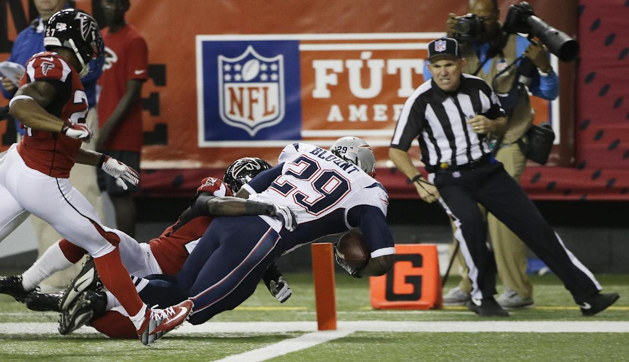 New England Patriots running back LeGarrette Blount (29) runs into the end zone as Atlanta Falcons cornerback Desmond Trufant, (21) makes the tackle during the second half of an NFL football game, Sunday, Sept. 29, 2013, in Atlanta. (AP Photo/John Bazemore)