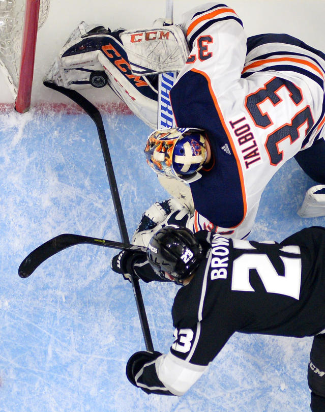 Los Angeles Kings right wing Dustin Brown, below, puts the puck over the line past Edmonton Oilers goaltender Cam Talbot with seconds to go in the third period of an NHL hockey game, Saturday, Feb. 24, 2018, in Los Angeles. The goal was called back for goalie interference. The Oilers won 4-3. (AP Photo/Mark J. Terrill)