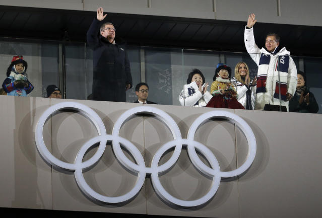 Thomas Bach, president of the International Olympic Committee, front left, South Korean President Moon Jae-in, front right, wave with Ivanka Trump, back right, U.S. President Donald Trump's daughter during the closing ceremony of the 2018 Winter Olympics in Pyeongchang, South Korea, Sunday, Feb. 25, 2018. (AP Photo/Natacha Pisarenko)